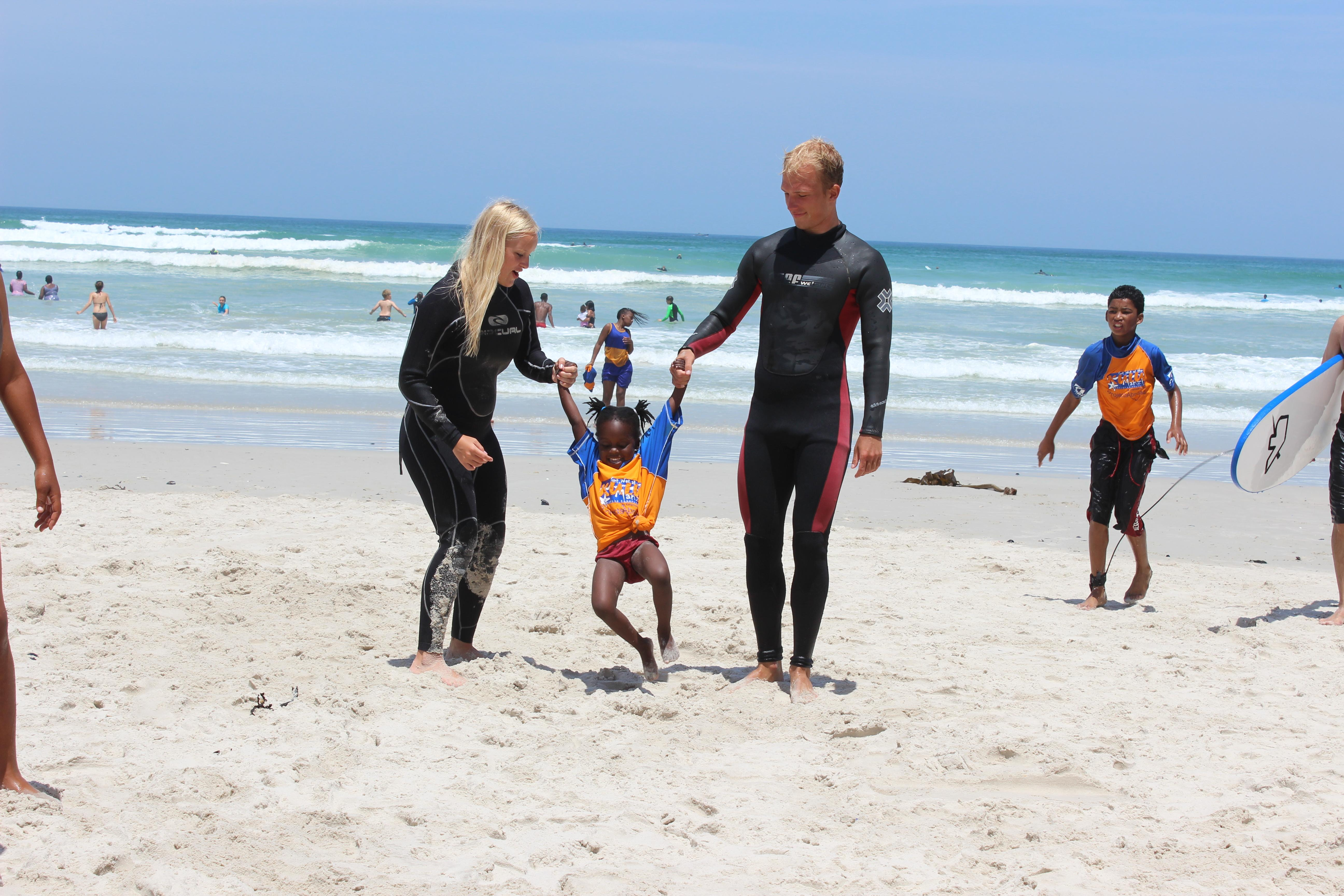Volunteers work with surfers and teach children to surf in South Africa